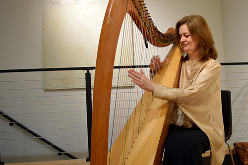 Image of a harpist at the Factory Mark Gallery grand opening